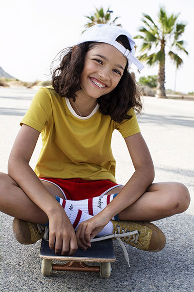 Miller Orthodontics emergency care, youth and kids orthodontics, Teen girl on skateboard, Miller Orthodontics is ready to fix any orthodontic & dental emergencies that require immediate attention.